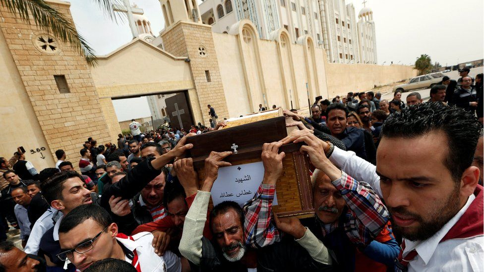 """Relatives react as they mourn for the victims of the Palm Sunday bombings during their funeral at the Monastery of Saint Mina """"Deir Mar Mina"""" in Alexandria"""