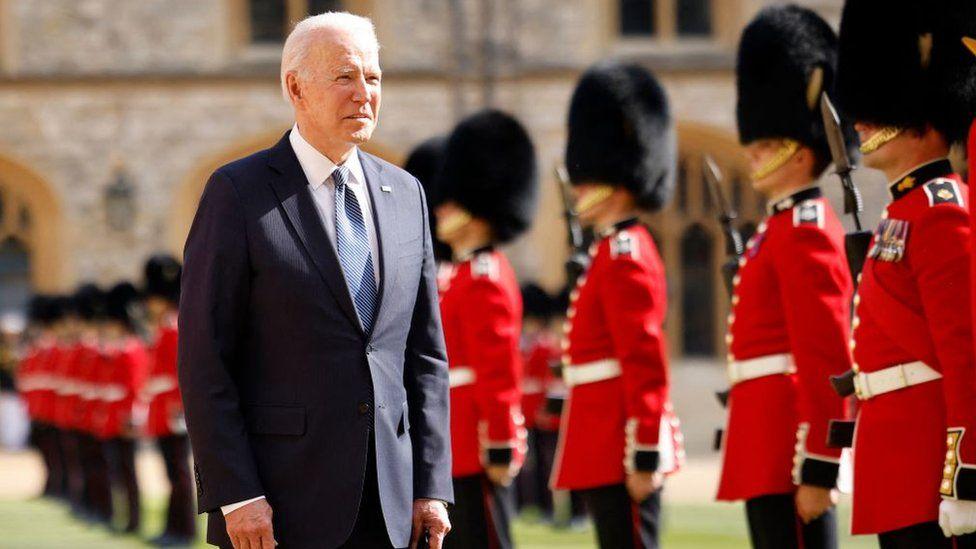 Joe Biden inspecting the troops