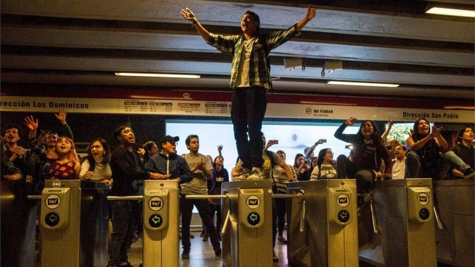 Students demonstrate at Los Heroes metro station during a mass fare-dodging protest in Santiago, Chile, on October 18, 2019