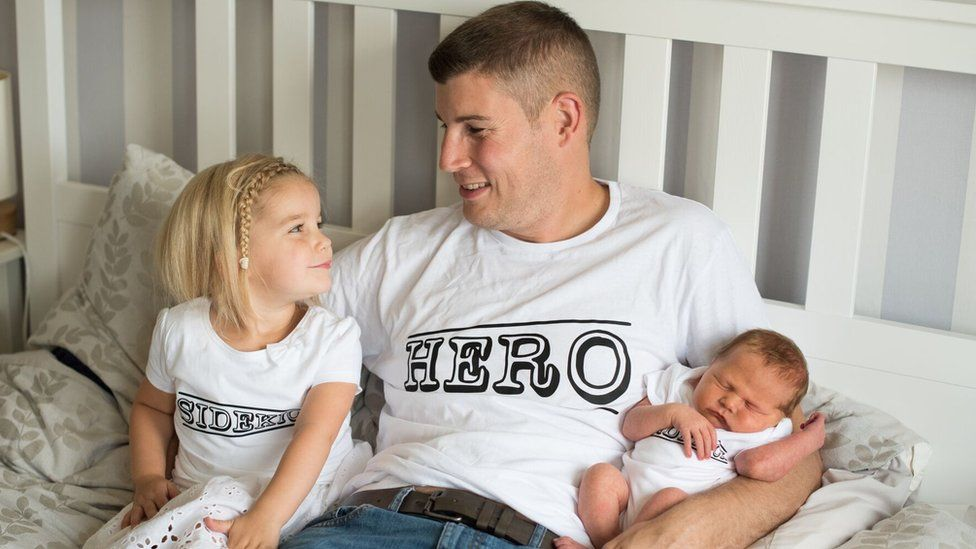 Brett Kinloch with his daughters Freya (left) and Ella (right)