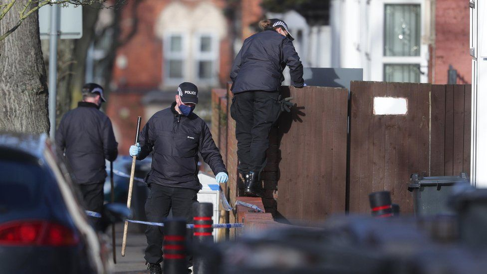 Police officers searching the scene in Linwood Road, Handsworth