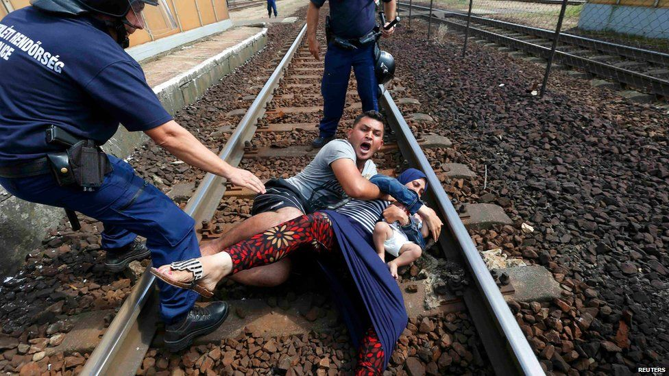 Migrant and police at Bicske, Hungary, 3 September 2015