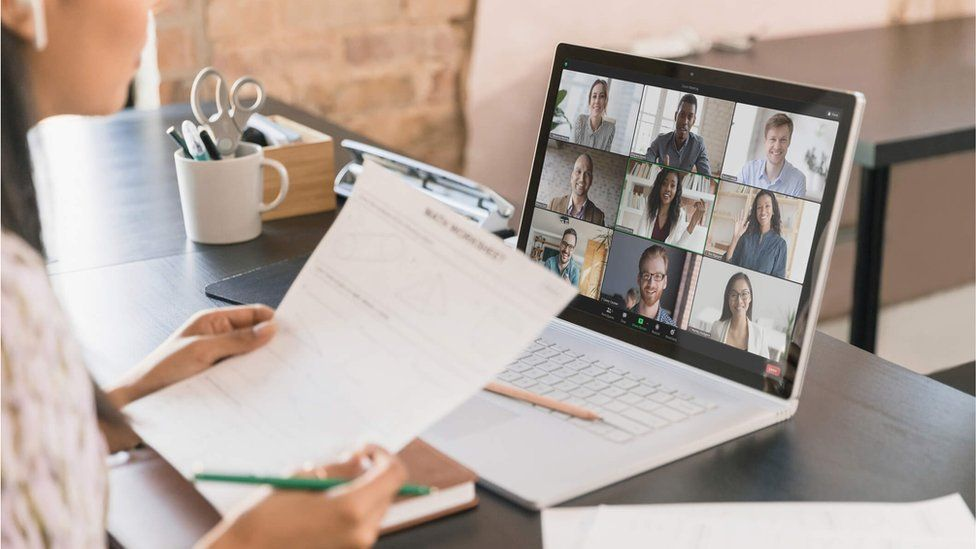 A woman attending a Zoom video conferencing meeting