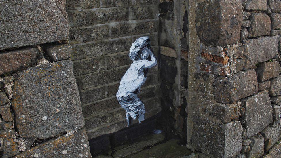 Banksy-style street art in Portstewart