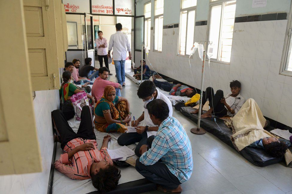 Doctors treating patients in on the floor of a hospital in Delhi