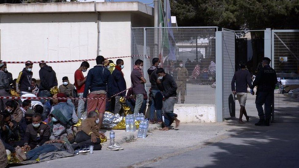 Group of migrants sleeping outside the camp