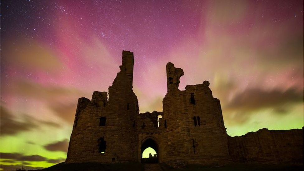 Dunstanburgh Castle near Alnwick in Northumberland made a dramatic setting for Phil Pounder's shot of pink shades of aurora borealis