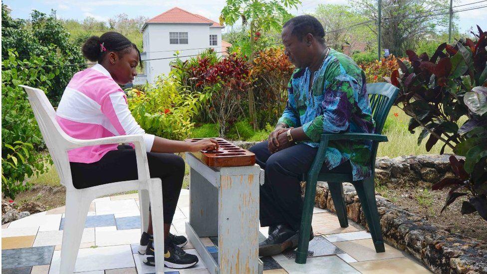 Multiple-time international Warri champion Trevor Simon playing against his young cousin and protégé Skye Simon