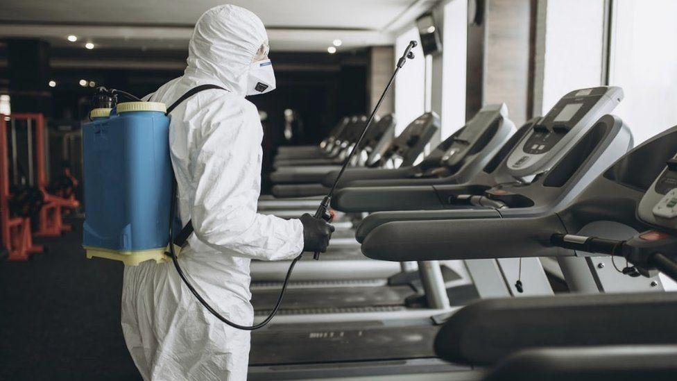 PSS worker decontaminating gym