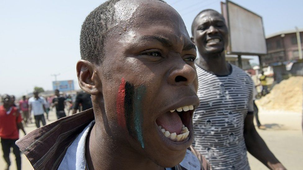 A pro-Biafra supporter chants a song in Aba, southeastern Nigeria, during a protest calling for the release of a key activist on November 18, 2015