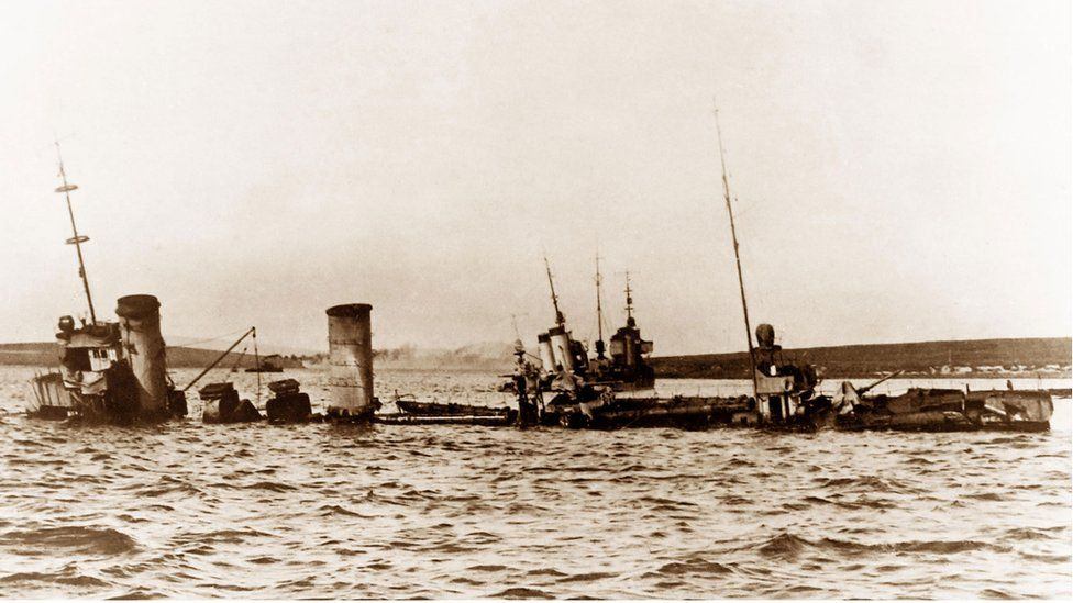 German battleships sinking off the island of Fara, Scapa Flow, Orkney, 21st June 1919 - Image ID: KW9521