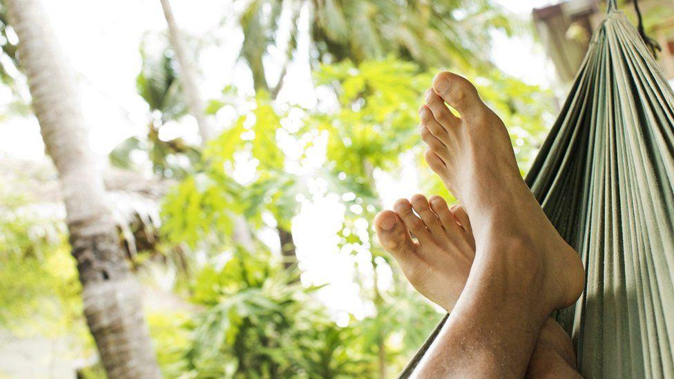 Feet relaxing on a hammock