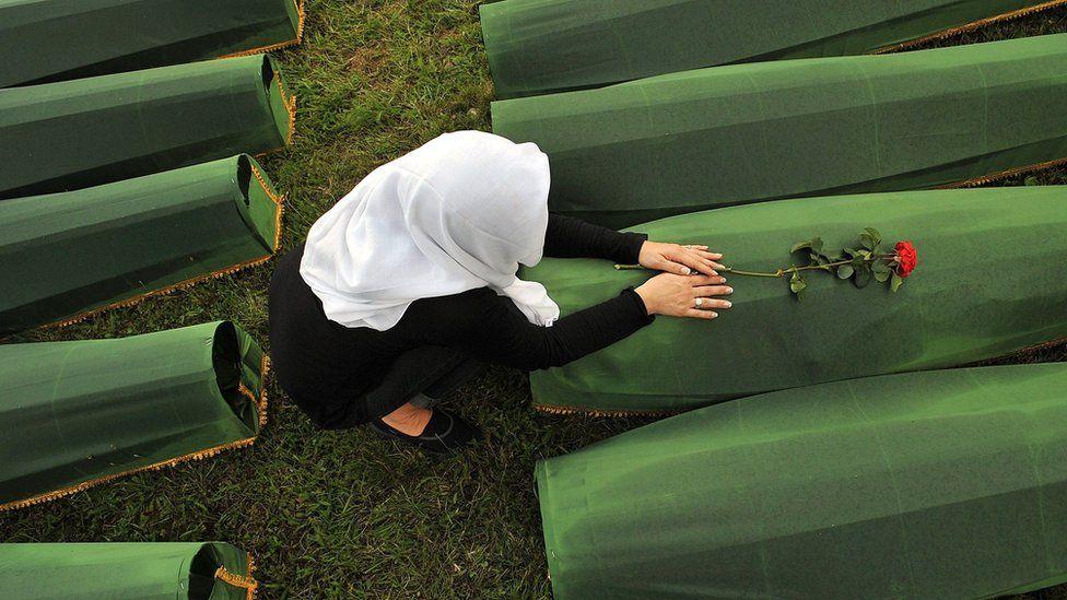 A picture taken on July 10, 2013 shows a Bosnian Muslim woman, survivor of Srebrenica 1995 massacre,