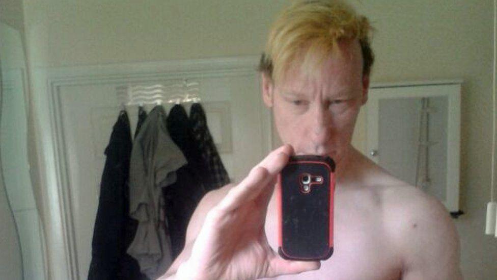 Stephen Port taking selfie, shirtless
