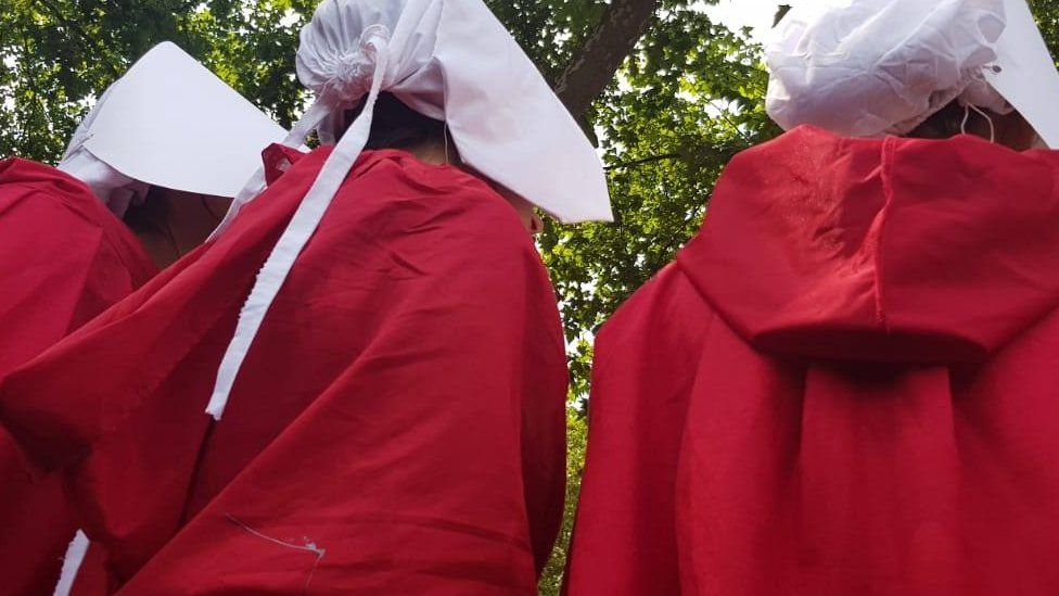 protesters dressed as handmaids during anti-Trump protests in London