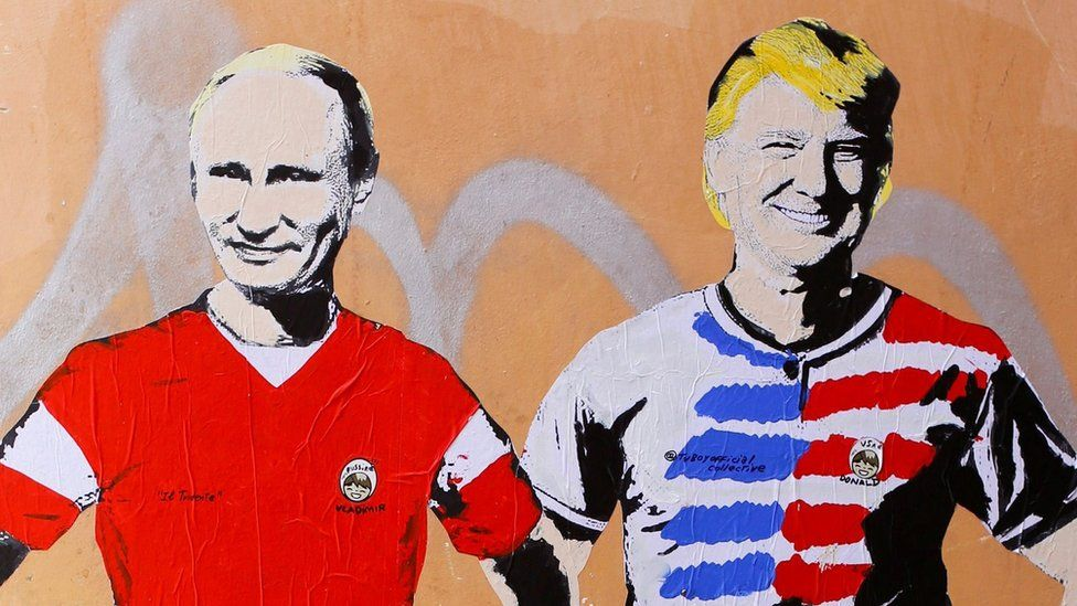 "A mural signed by ""TV Boy"" and depicting Russian President Vladimir Putin and US President Donald Trump as soccer players"