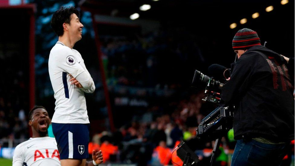 Tottenham Hotspur's South Korean striker Son Heung-Min celebrates in front of TV camera after goal v Bournemouth
