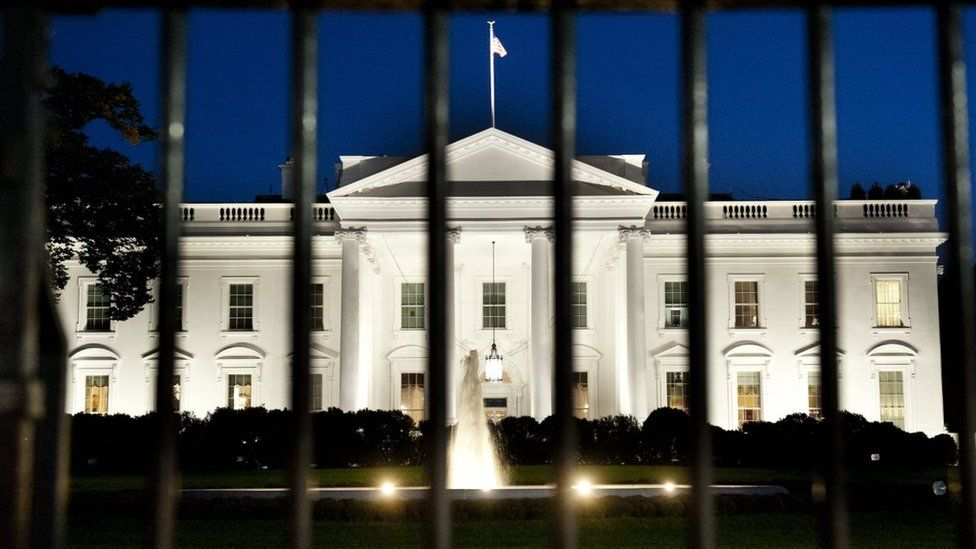 The White House is seen at dusk on the eve of a possible government shutdown as Congress battles out the budget in Washington, DC, September 30, 2013.