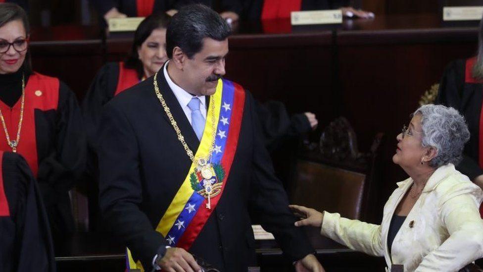 Venezuelan President Nicolas Maduro greets Tibisay Lucena during a ceremony in Caracas, Venezuela, 31 January 202