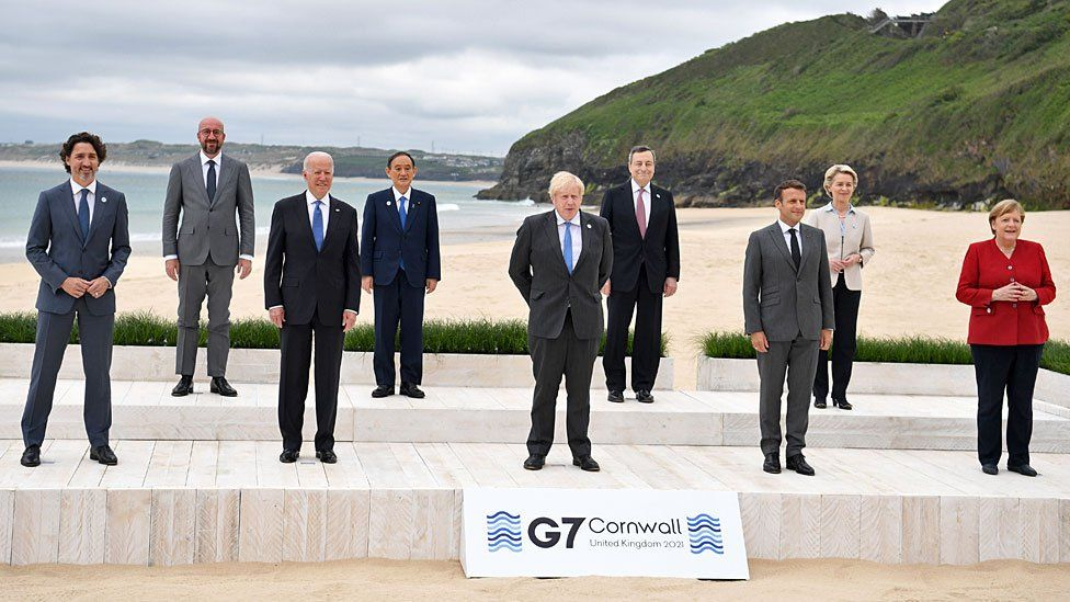 Nine world leaders gather on the beach in Carbis Bay for a photograph together
