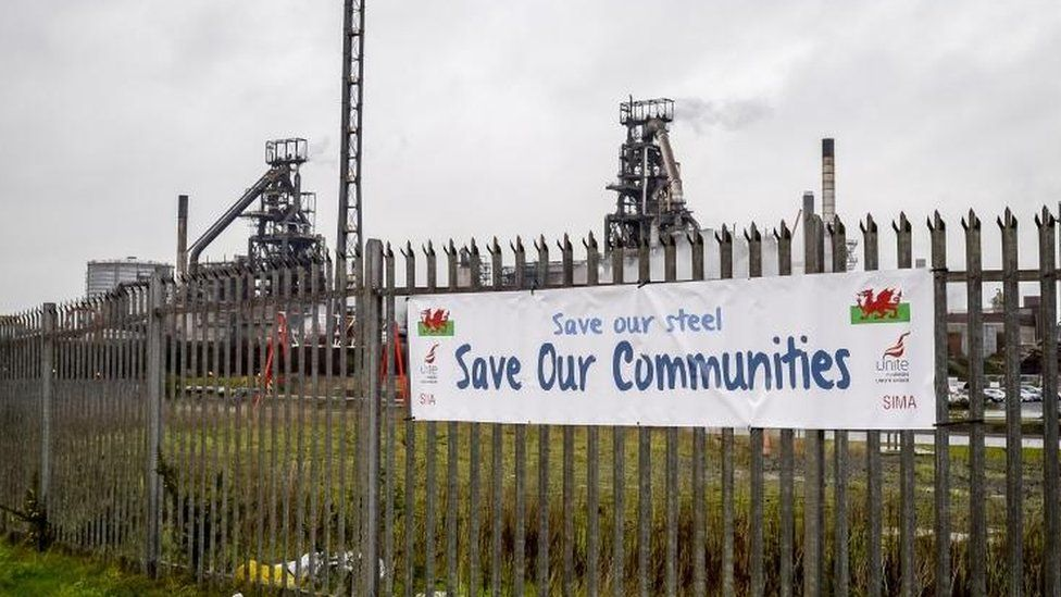 A Unite union banner on the fence outside the Tata steel plant in Port Talbot