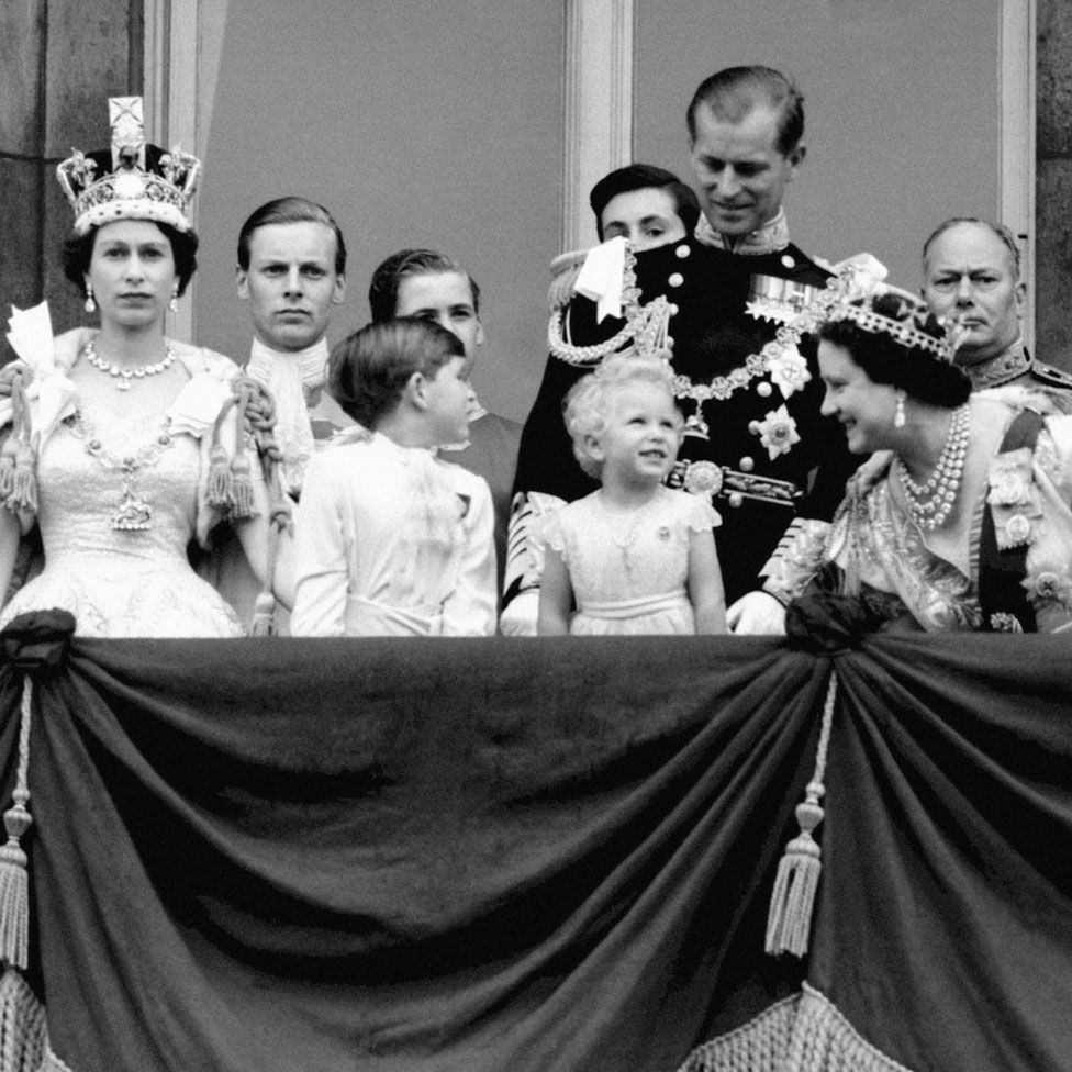 Queen Elizabeth II, Prince Charles, Princess Anne, the Duke of Edinburgh, the Queen Mother, and the Duke of Gloucester on the balcony of Buckingham Palace to view the fly past of the Royal Air Force after the Coronation