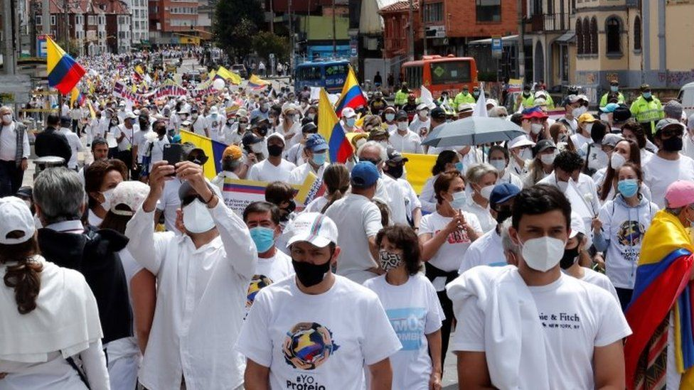 """People participate in a march that rejects and calls for the end of the """"National Strike"""" and the violence that arises from the demonstrations against the Government, which completed a month, in Bogota, Colombia, 30 May 2021"""