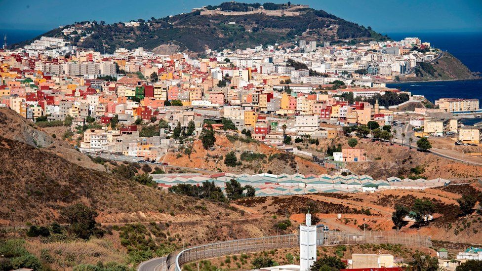 A picture taken from the Moroccan town of Fnideq shows a general view of Spain's North African enclave of Ceuta which lies on the Strait of Gibraltar on August 29, 2020.