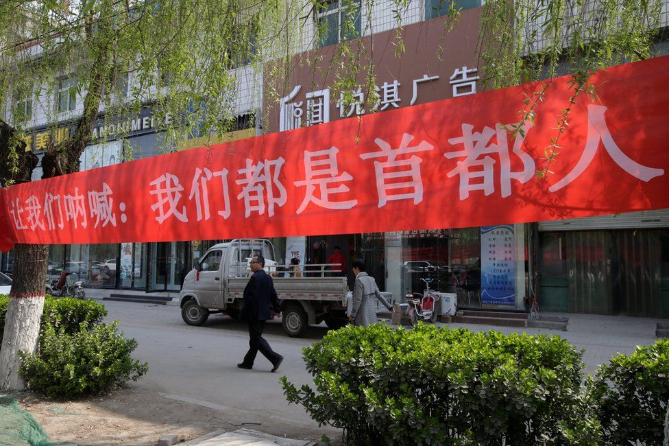 """Banner saying """"We are all residents of the capital"""" is seen in Xiongxian, Hebei province, China, 3 April 2017."""