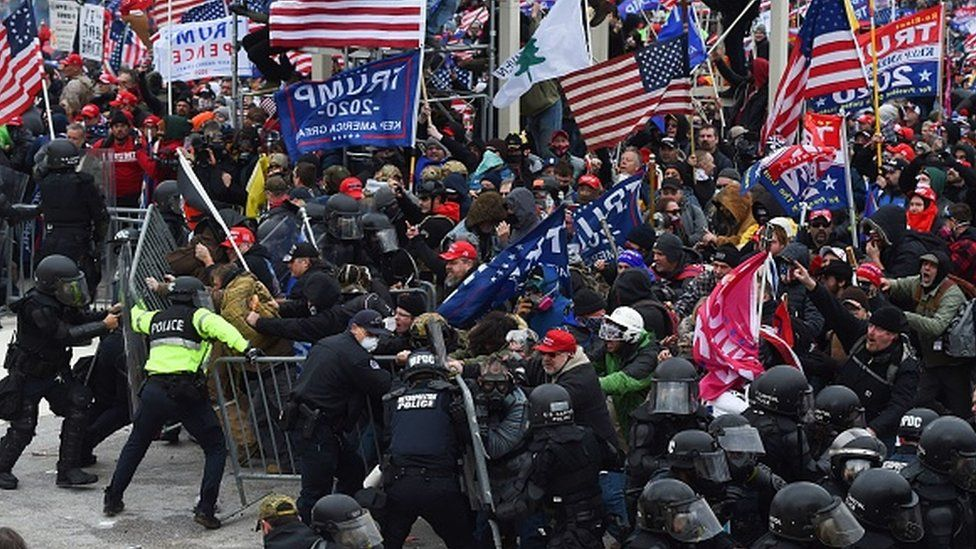 Donald Trump supporters clash with police and security forces as they push barricades to storm the US Capitol in Washington DC. Photo: 6 January 2021