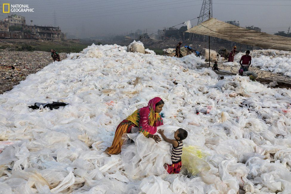 Clear plastic sheeting being spread out to dry in Bangladesh