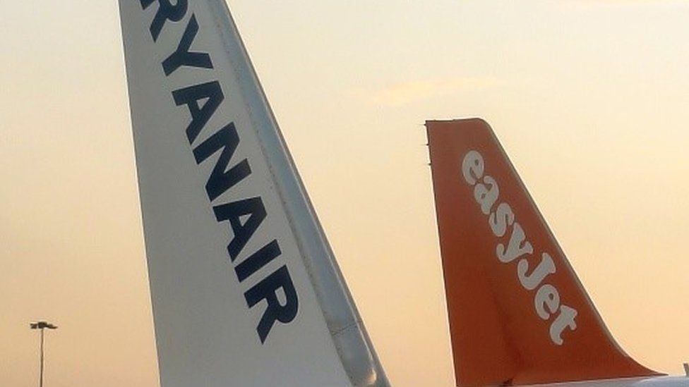 Tail fins of EasyJet and Ryanair planes