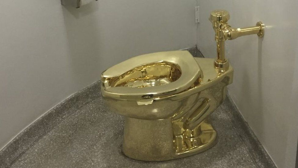 Maurizio Cattelan gold toilet set for Blenheim Palace appearance