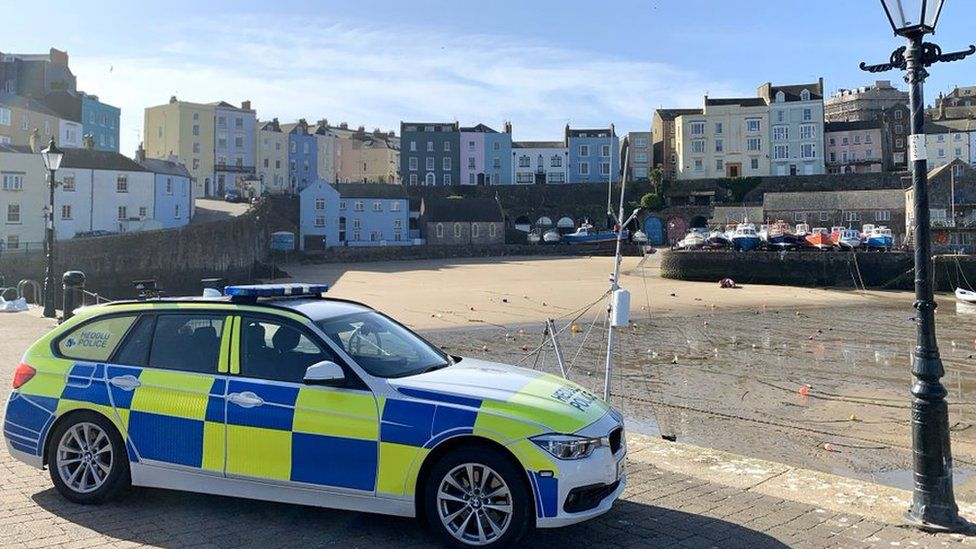 police car in Tenby harbour