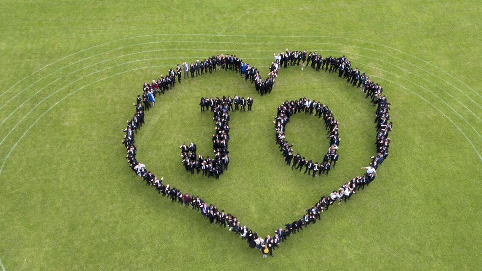 Pupils at Cockshut Hill School in Birmingham form a heart-shaped human chain and spell out the words ÔJoÕ to mark the Great Get Together weekend in memory of MP Jo Cox.