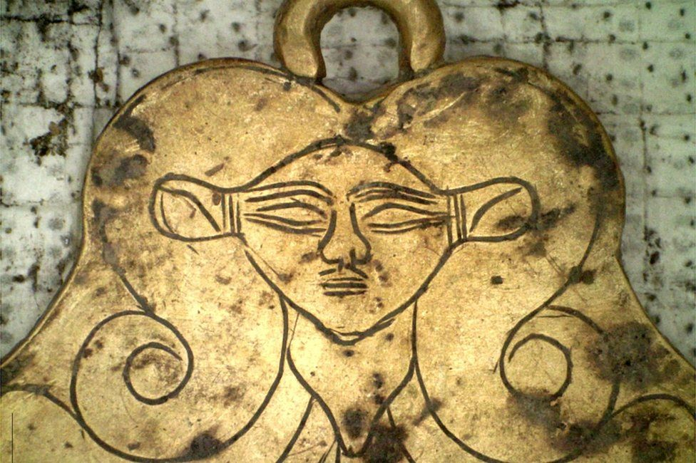 A pendant depicting the head of ancient Egyptian goddess Hathor