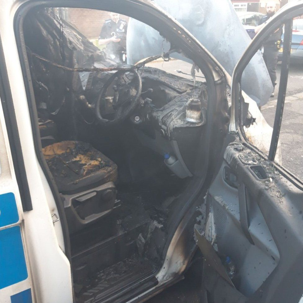 The inside view of the fire-damaged van