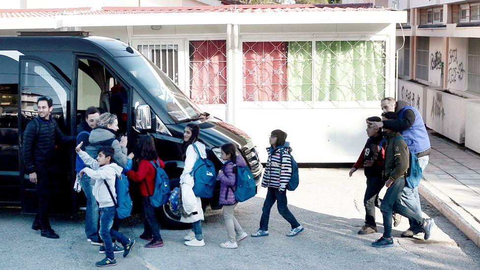 Refugee children boarding a bus in Oraiokastro, near Thessaloniki, 20 Feb 17