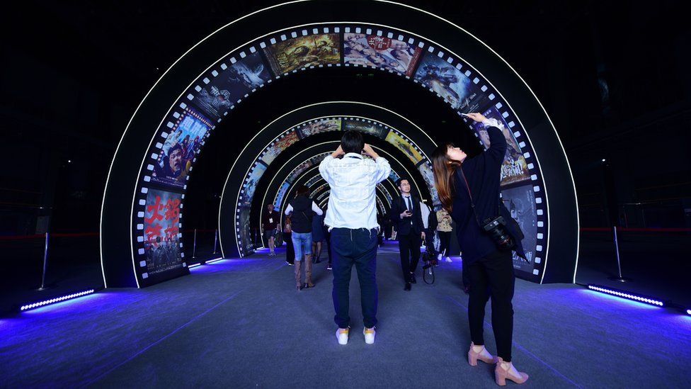 People visit a film studio at Wanda Film industrial park in Qingdao, China's Shandong province on April 28, 2018
