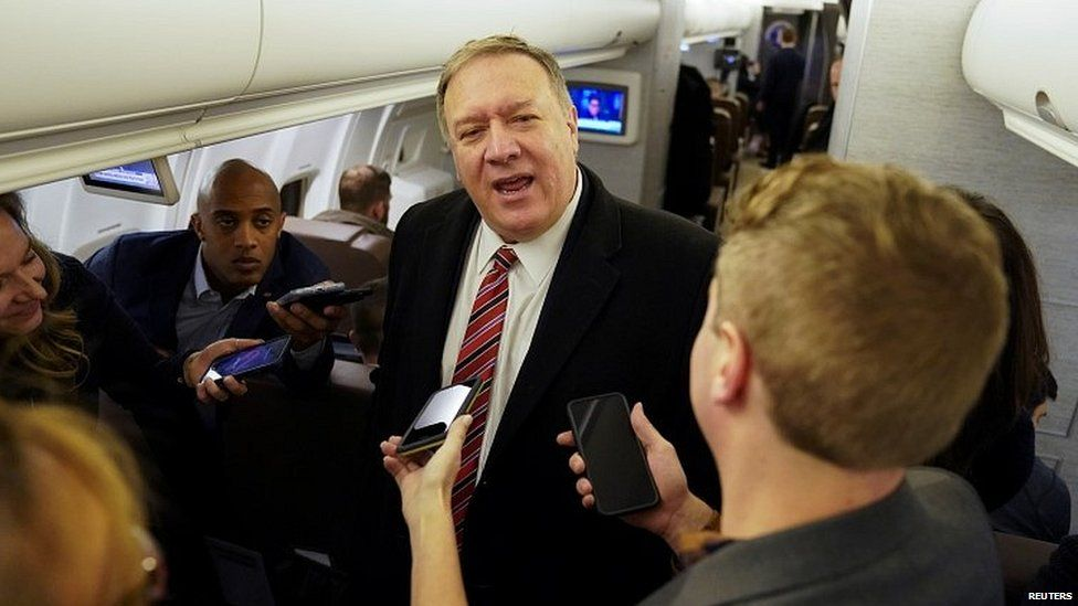 Mike Pompeo talking to reporters on the plane to London