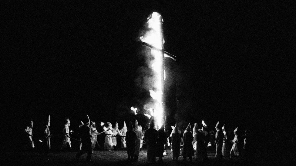 KKK members gather for a cross burning in 1994