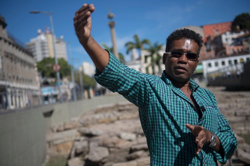 Brazilian Claudio Honorato, a researcher at the Institute of New Blacks and curator of the mass grave site, speaks at the Valongo Wharf, in Rio de Janeiro, Brazil, 28 June