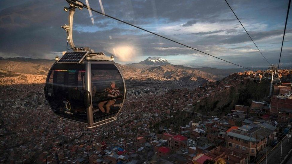 View from a cable car of La Paz with the Illimani mountain in the background in El Alto, Bolivia