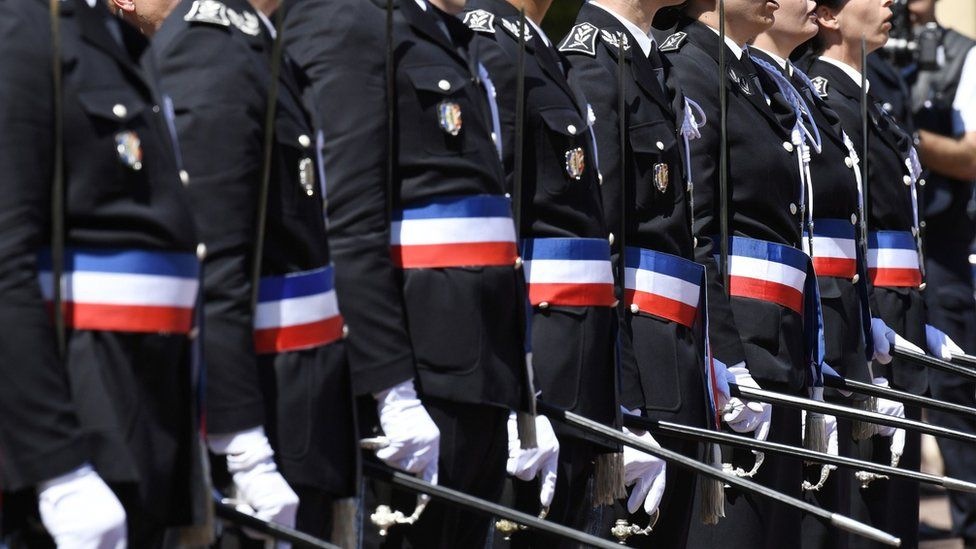 """Newly promoted police officers stand guard during a ceremony of the 20th promotion of the police officers at the Saint-Cyr national school of police on June 24, 2016 in the Saint-Cyr-au-Mont-d""""Or near Lyon"""