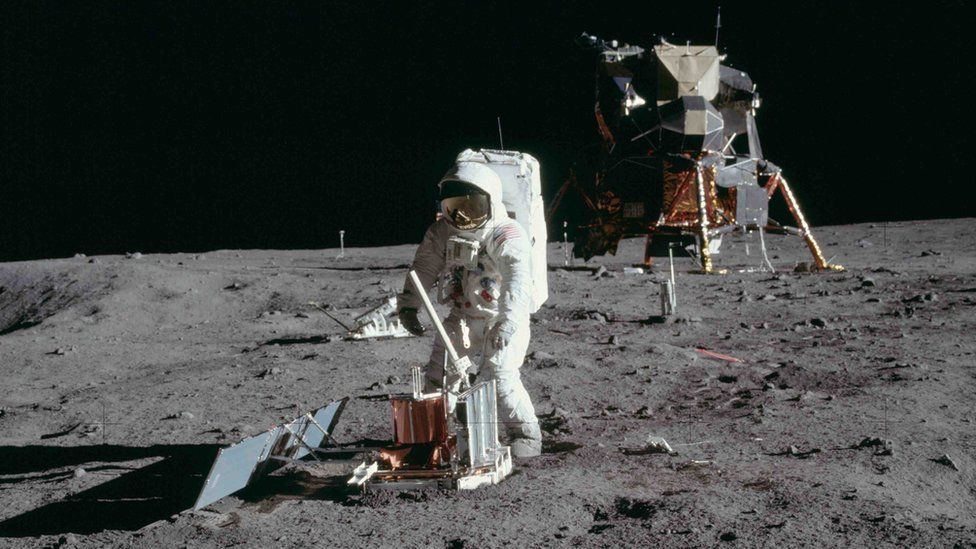 Buzz Aldrin deploys a scientific research package on the surface of the moon on July 20 1969
