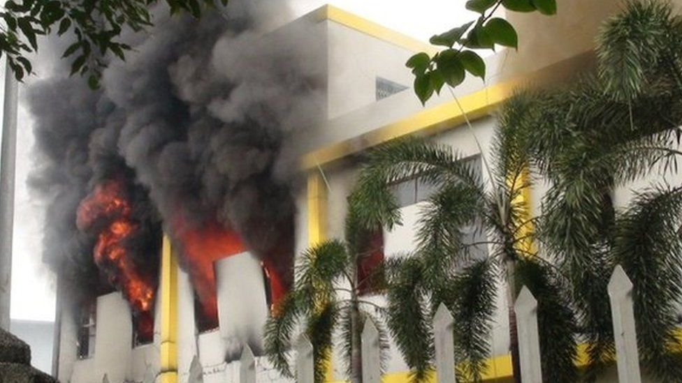 Smoke and flames billow from a factory window in Binh Duong on 14 May as anti-China protesters set several factories on fire in Vietnam, according to state media, in an escalating backlash against Beijing's deployment of an oil rig in contested waters.