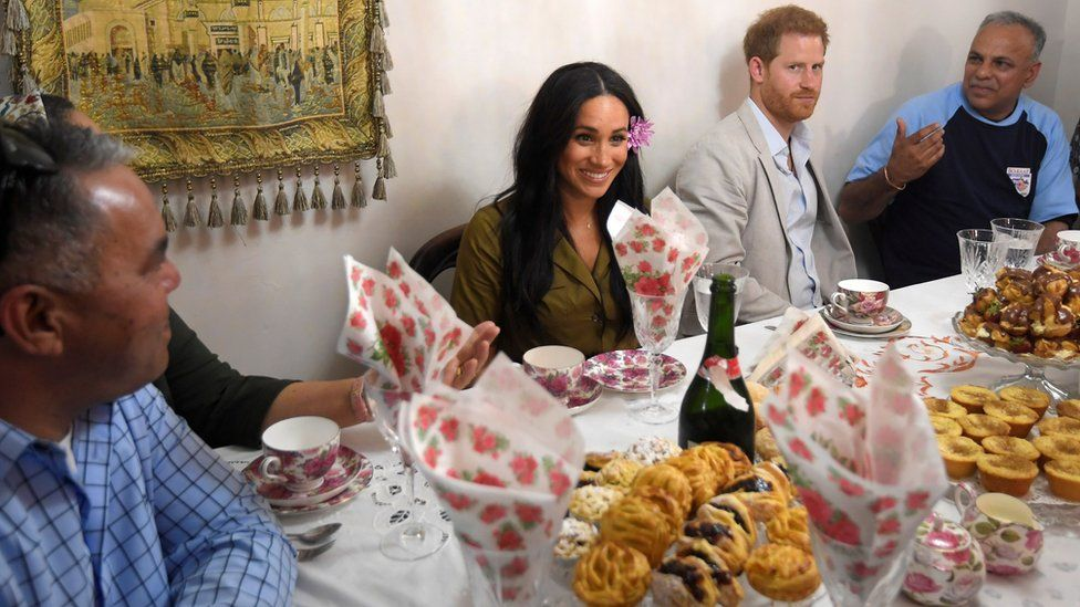 Harry and Meghan at a family's home in Cape Town
