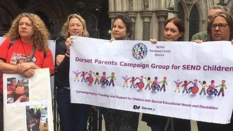 Parents protested at the High Court in June