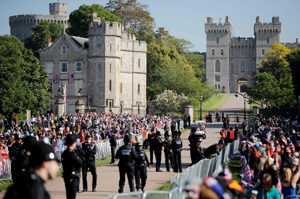 Well-wishers gather along the Long Walk leading to Windsor Castle ahead of the wedding and carriage procession of Britain's Prince Harry and Meghan Markle in Windsor