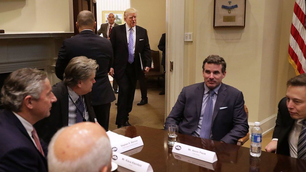 President Donald Trump walks into the Roosevelt Room for a meeting with Mark Sutton of International Paper, Jeff Fettig of Whirlpool, White House Senior Counselor Steve Bannon, Kevin Plank of Under Armour, Elon Musk of SpaceX (L) and other other business leaders at the White House on 23 January 2017 in Washington, DC.